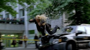 Olivia goes through windshield