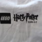 Cleaning out the coffers again...this time we have a HP Lego Years 5-7 T-Shirt & a Voldemort Mini Fig