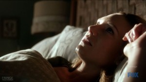 Olivia wakes in bed