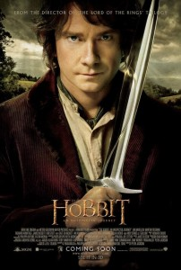 Bilbo carrying a sword