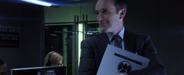 agents of shield, s1 ep01--Agent Coulson clutching binder in HQ