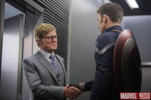 Alexander Pierce shaking hands with Steve Rogers