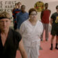 Cobra Kai's cast and crew discuss what's in store for Season 2, and whether Johnny Lawrence can make up with his son or teach his other kids something other than his previously merciless philosophy.